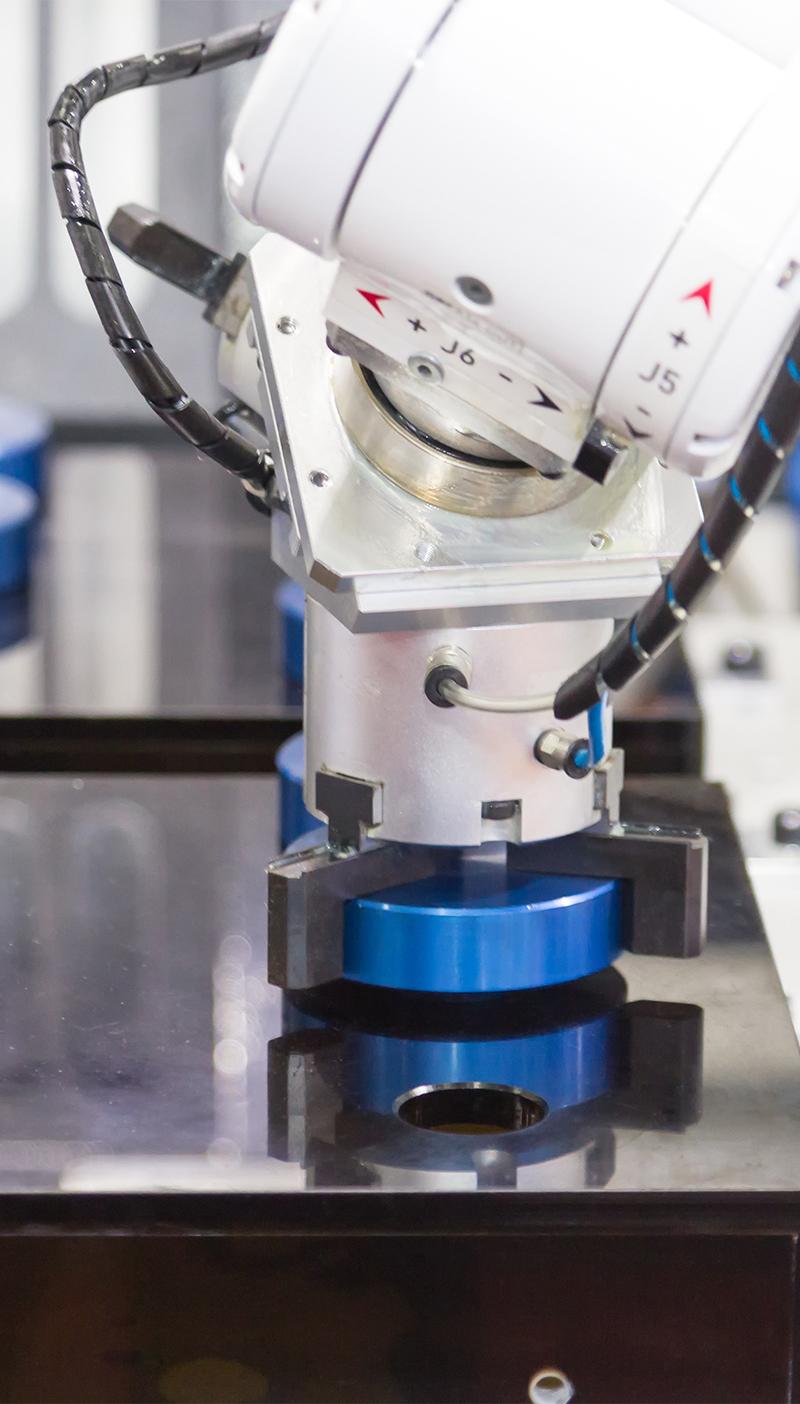 Mechanical hand robot working with CNC lathe machine